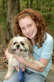 A girl and her dog — Stock Photo