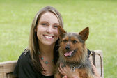 Woman and dog in the park — Stock Photo
