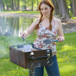 Stock Photo: Womcooking bbq