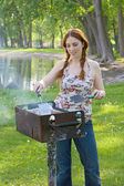 Woman cooking bbq — Stock Photo