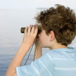 Boy binoculars — Stock Photo