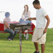 Guy cooking bbq — Stock Photo #2420089