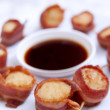Scallops wrapped in bacon — Stock Photo