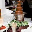 Chocolate fountain spread - Stock Photo