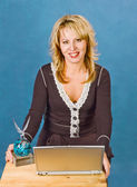 Businesswoman with cup and laptop — Stok fotoğraf