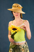 Young women with sunflowers — Stock Photo