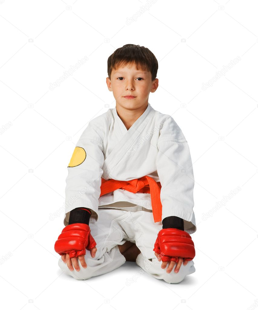 A young boy aikido fighter in white kimono — Stock Photo #1991597