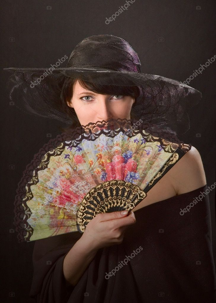 Portrait of a young sexy woman with fan — Stock Photo #1992091