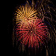 Stock Photo: Red, white, gold and blue fireworks
