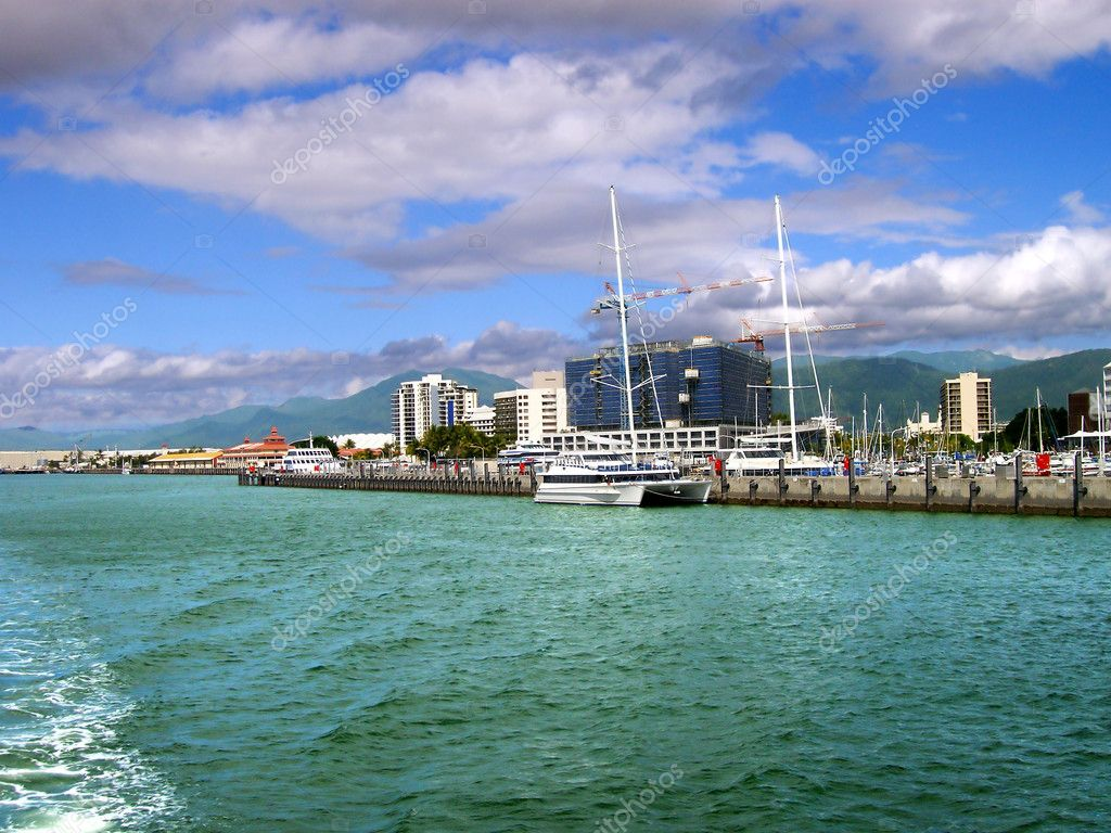 View of the waterfront of Cairns, Australia under blue sky and clouds from the water  Stock Photo #2579569