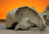 Sculpted rock formation and orange sky — Stock Photo