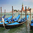 Gondolas moored by a piazzetta - Stockfoto