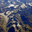 Foto Stock: Aerial view of glacier and lake