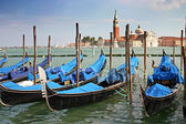 Gondolas moored by a piazzetta — Stock Photo