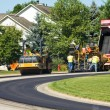 Laying new pavement - Stock Photo