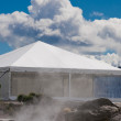White Tents, smoke and sunny day. — Stock Photo