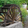 Stock Photo: Old wooden Water wheel and stream