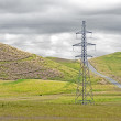 High voltage tower with cloudy sky — 图库照片