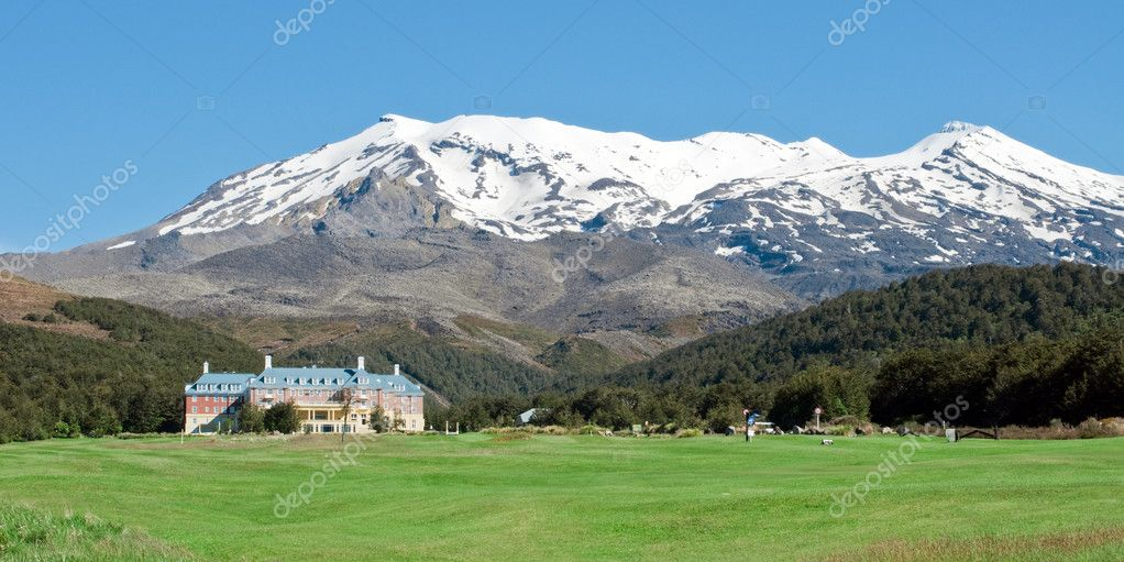 Historic building with snow capped mountain in New Zealand  Stock Photo #2073230