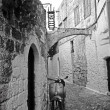 Stock Photo: Historic stone alley and scooter