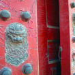 Red, historic wooden door - Stock Photo