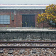 Stock Photo: Red bricks building and rail
