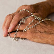 Rosary hands - Stock Photo