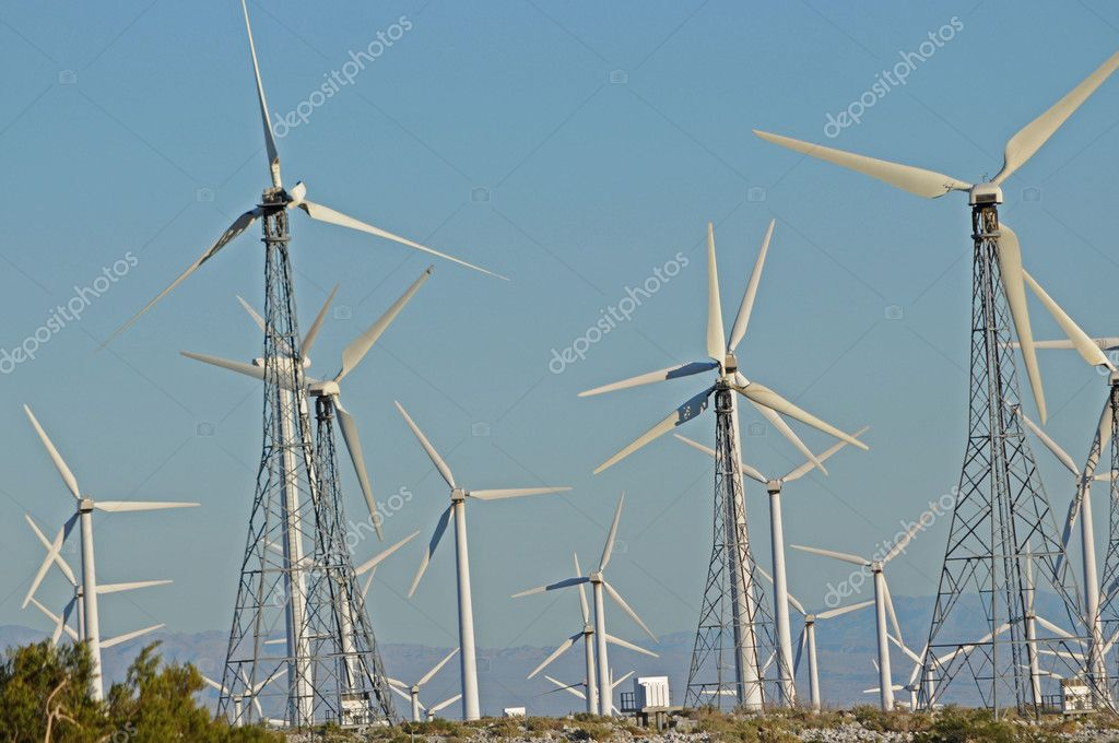 Field of metal wind turbines against blue sky — Stock Photo #1877922