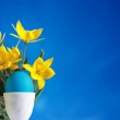 Blue easter egg and yellow tulips — Stock Photo #2514236