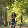 Woman riding a bicycle — Stock Photo #1946725