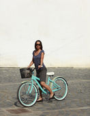 Woman With A Bicycle In A City — Stock Photo