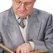Senior reading a book - Stock Photo
