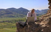 Businessman on a computer outdoors — Stock Photo