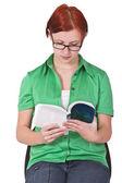 Redheaded girl reading — Stock Photo