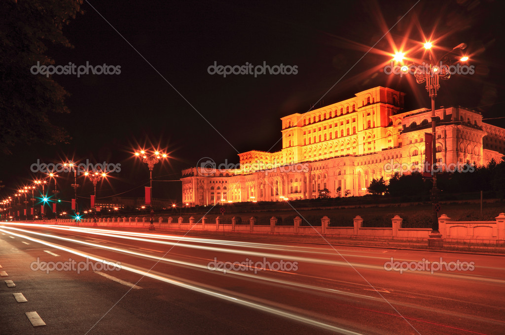 Cars light trails during the night in front of the Palace of the Parliament in Bucharest, Romania.  — Stock Photo #1981208