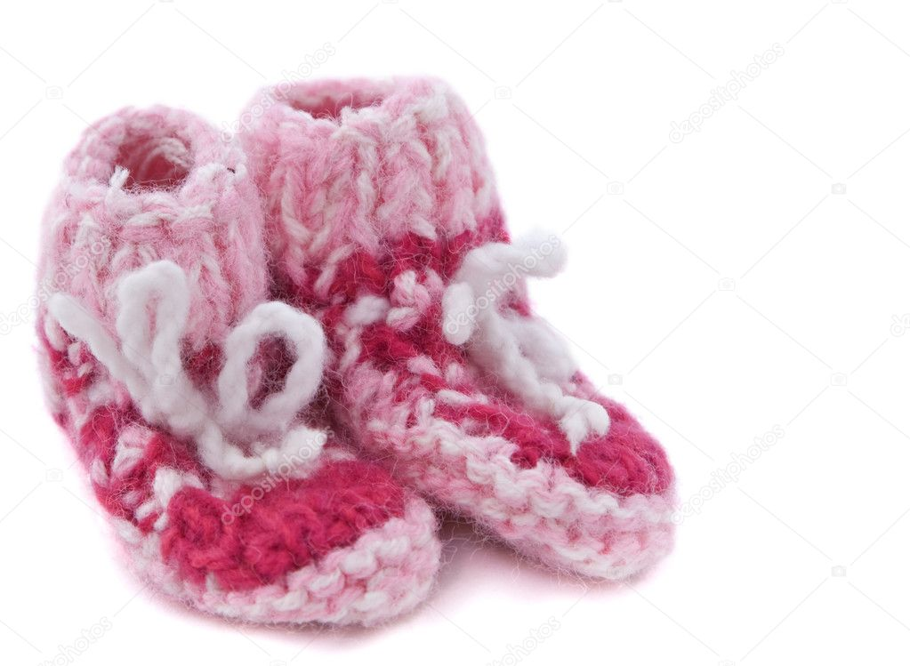 Knitted baby footwear isolated against a white background.  Stock Photo #1984978