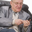 Stock Photo: Senior using a mobile phone