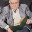 Senior reading a book — Stock Photo