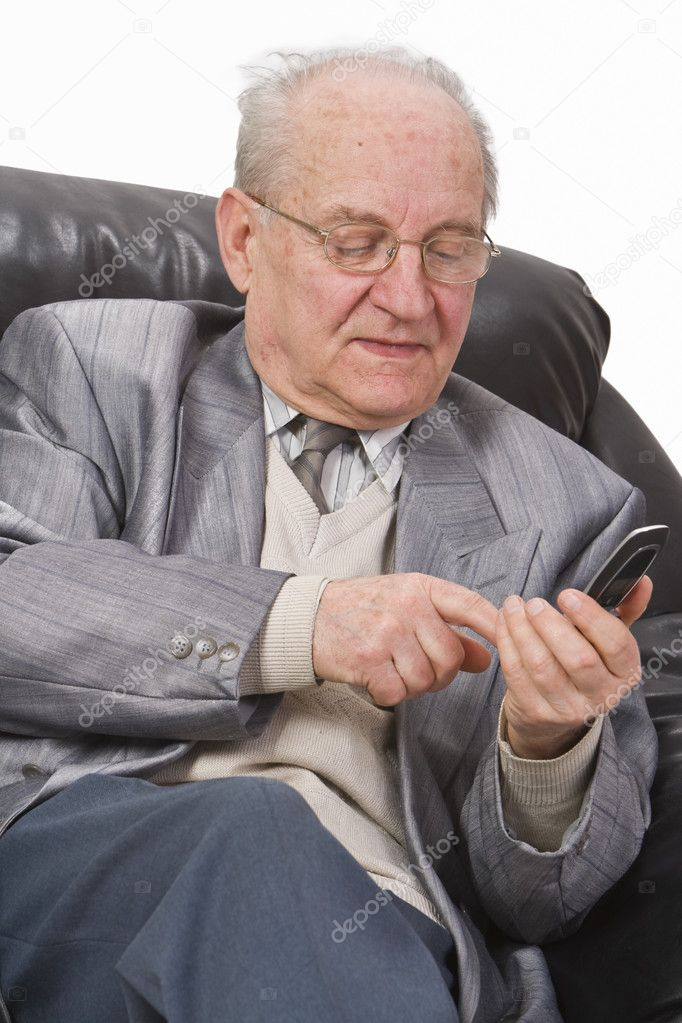 Close-up image of a senior man typing a message on his mobile phone. — Stock Photo #1994484