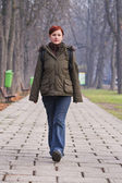 Teenager walking in a park — Stock Photo