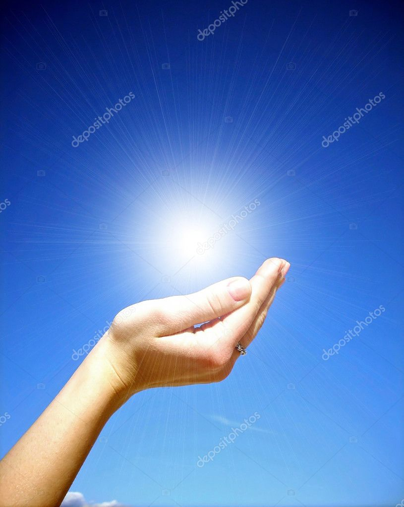Hand holding the sun — Stock Photo #2088074