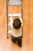 Little boy on the steps — Stock Photo