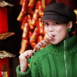 Chingirl eating candied fruit — Stock Photo #1821581