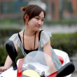 Stock Photo: Beautiful woman on Motorcycle