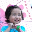 Little girl hold umbrella — Stock Photo