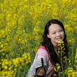 Royalty-Free Stock Photo: Pretty girl in rape flowers