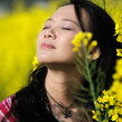 Pretty girl in rape flowers — Stock Photo #2570098