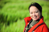Asian woman grass in red — Stock Photo