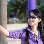 Fashion girl with sunglasses in purple — Stock Photo #2595746