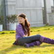 Beautiful girl in sunshine on grass — Stock Photo